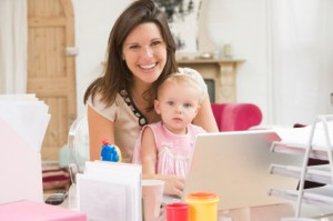 mother and baby in front of laptop