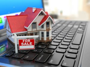 Real estate agency online. House on laptop keyboard. 3d